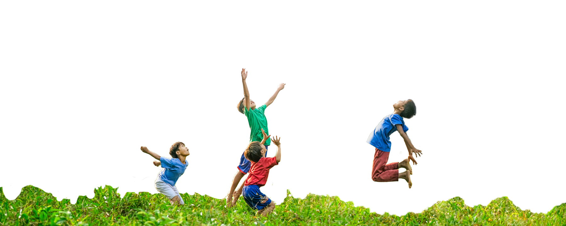 Four Boys Jumping in Grass at Dream Big Summer Day Camp | Hilltop Denver and Greenwood Village