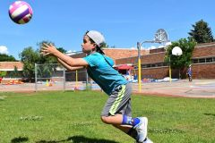 Boy Hitting a Volleyball at Dream Big | Hilltop Denver and Greenwood Village